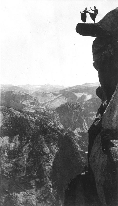 Distant silhouette view of Kitty Tatch and friend dancing on the overhanging rock at Glacier Point, Yosemite, 1890s; with distant view to northeast. Thanks to National Parks Service Historical Images Gallery online.