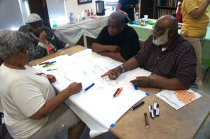 Trevonia, Sam and Joycelyn work on getting all the churches on the right streets (they move around!).