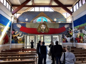 Another congregations, this one Catholic in CastelvonTuro, north of Naples. The astonishing sanctuary murals done by one of the thousands of immigrants the church serves.
