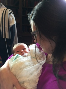 Lauren holds Charles Isaac Gunderson Wolfe during the B'rit Milah.
